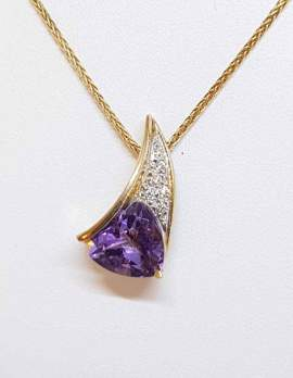 gold necklace with heart shape amethyst and diamonds