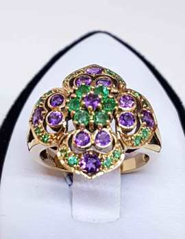 gold ring emerald and amethyst cluster floral design