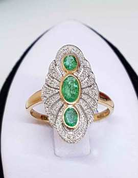 9ct Gold oval ring- 3 oval Emeralds surrounded by Diamonds