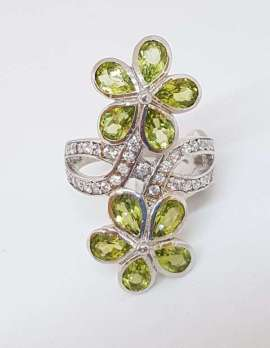 Sterling Silver Peridot flower ring with cubic zirconia