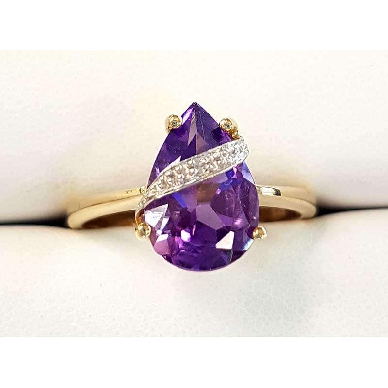 amethyst and diamond gold ring. teardrop shape