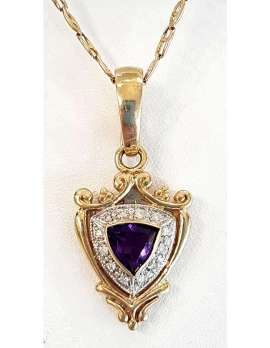 Amethyst in gold shield setting