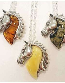 sterling silver and amber horse pendants