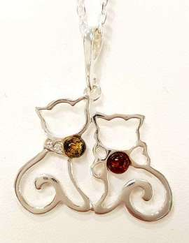 Sterling silver amber pendant two cats