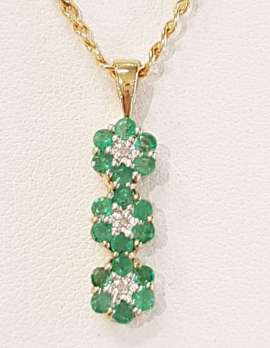 9ct Gold Emerald and Diamond Daisy Cluster Pendant on 9ct Chain