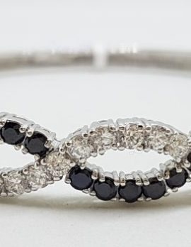 Sterling Silver Cubic Zirconia Black & White Weaved Pattern Oval Bangle