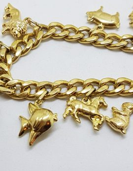 9ct Yellow Gold Charm Bracelet - 8 Charms with Bolt Clasp *SOLD*