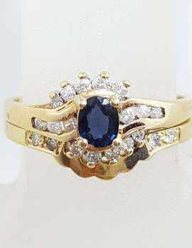 9ct Yellow Gold Oval Natural Blue Sapphire Surrounded by Claw and Channel Set Diamonds Engagement and Wedding Ring Set
