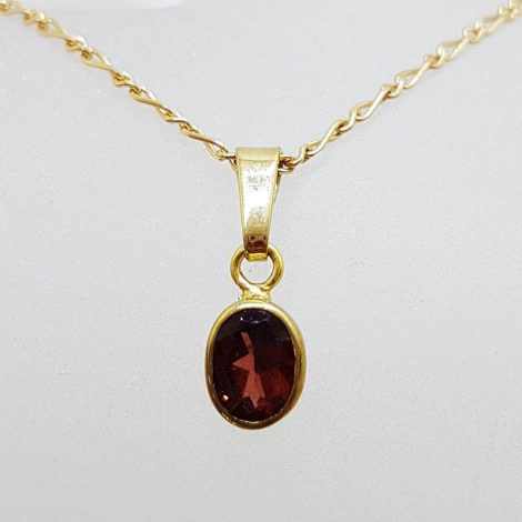 9ct Yellow Gold Oval Bezel Set Garnet Pendant on Gold Chain