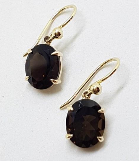 9ct Yellow Gold Oval Claw Set Smokey Quartz Drop Earrings