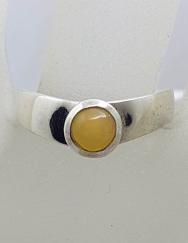 Sterling Silver Round Butter Amber in Curve Ring