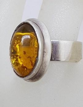 Sterling Silver Oval Bezel Set Amber Ring
