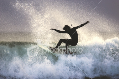 ist2_4294859-surfer-on-the-lip-of-a-wave