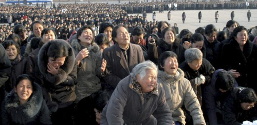 North Koreans cry in front of the Statue of the Sun in Pyongyang in this picture released by the North's official KCNA news agency December 20, 2011. North Korea was in seclusion on Tuesday, a day after it announced the death of its leader Kim Jong-il, as concern mounted over what would happen next in the deeply secretive nation that is trying to build a nuclear arsenal.   REUTERS/KCNA (NORTH KOREA)  NO THIRD PARTY SALES. NOT FOR USE BY REUTERS THIRD PARTY DISTRIBUTORS