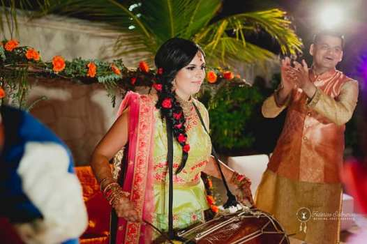 Reena plays drum on her sangeet event on indian wedding celebration