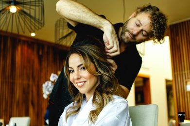 hairstylist finishes bridal hair do