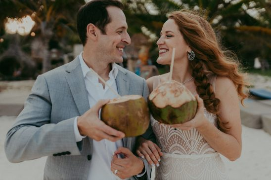 couples drinking coconut water at Mia Tulum on their wedding day