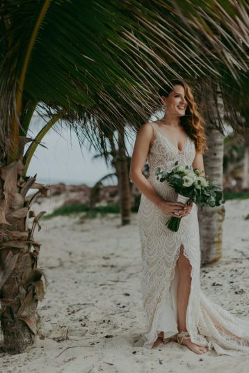 absolutely gorgeous bride shelley posing after wedding ceremony in Tulum,mexico