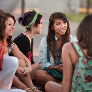Female Latino Students Talking Outdoors