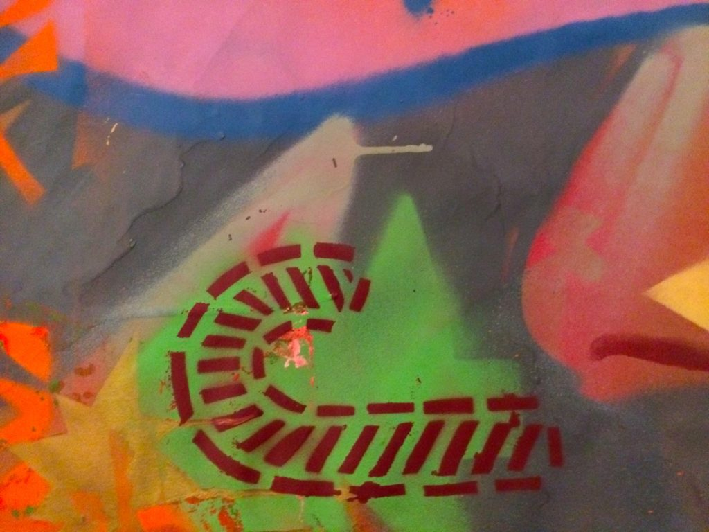Detail of wrapping paper, candy cane stencil over green tree with Alex Feliciano