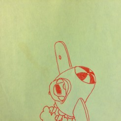 drawing of airplane on post-it note with red pen
