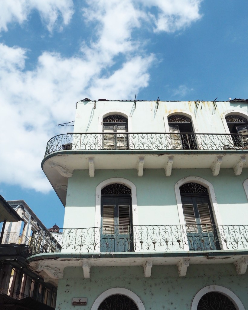 a turquoise building in Casco Viejo Panama