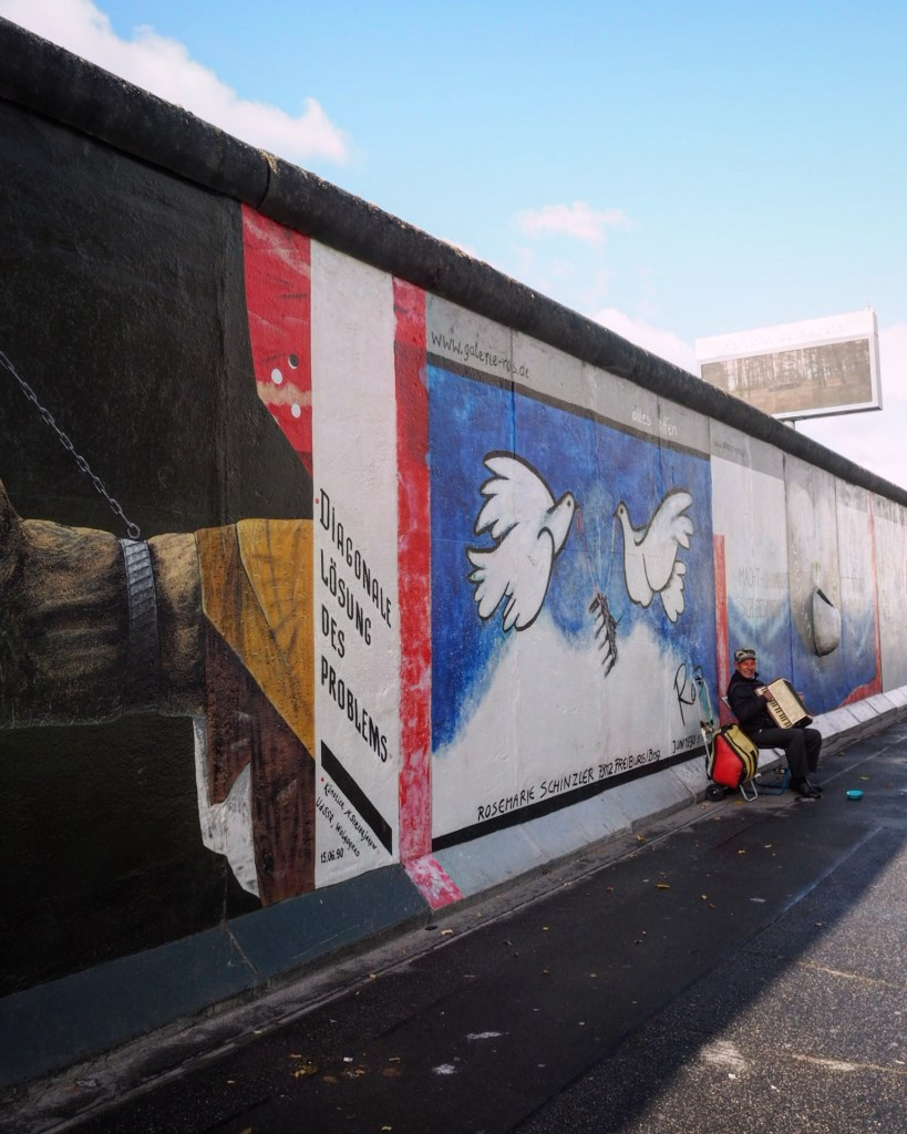best free places to visit in Berlin- accordion at East Side Gallery