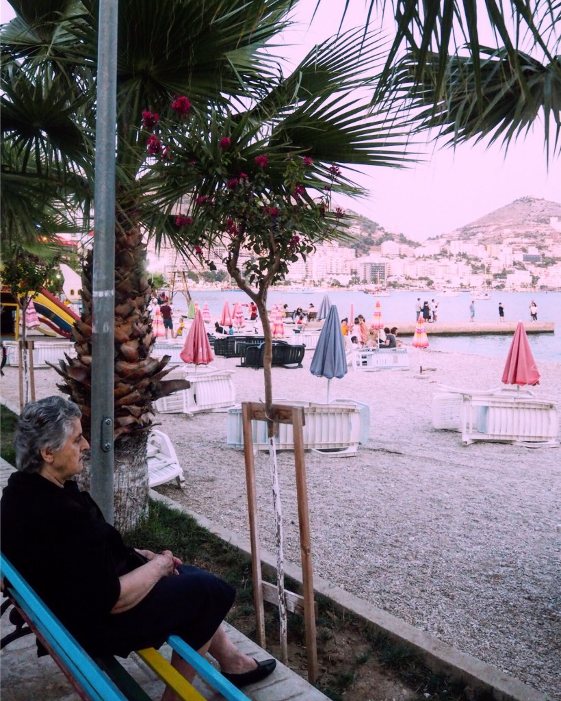 Albanian Grandma sitting by beach