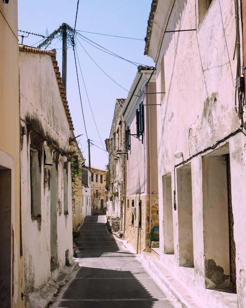 an empty white alleyway in Greece