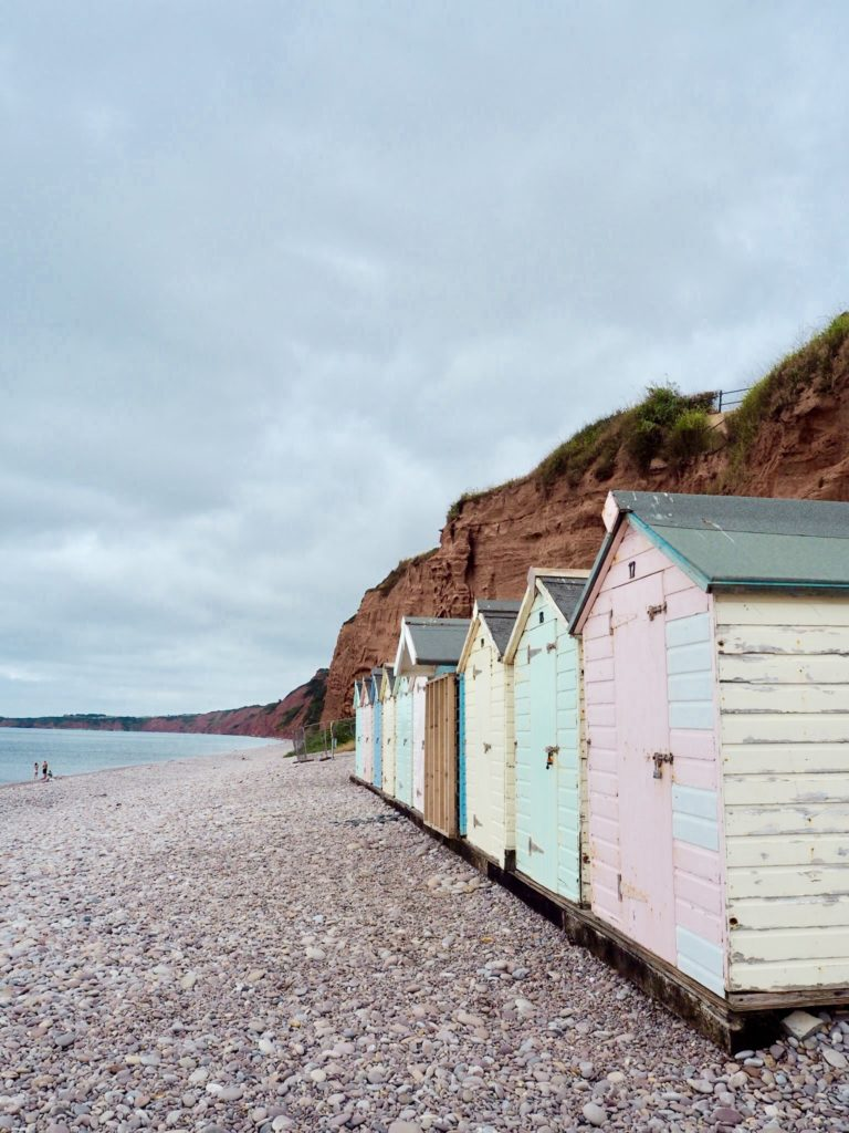 pastel beach huts on the English coast - South Devon things to do
