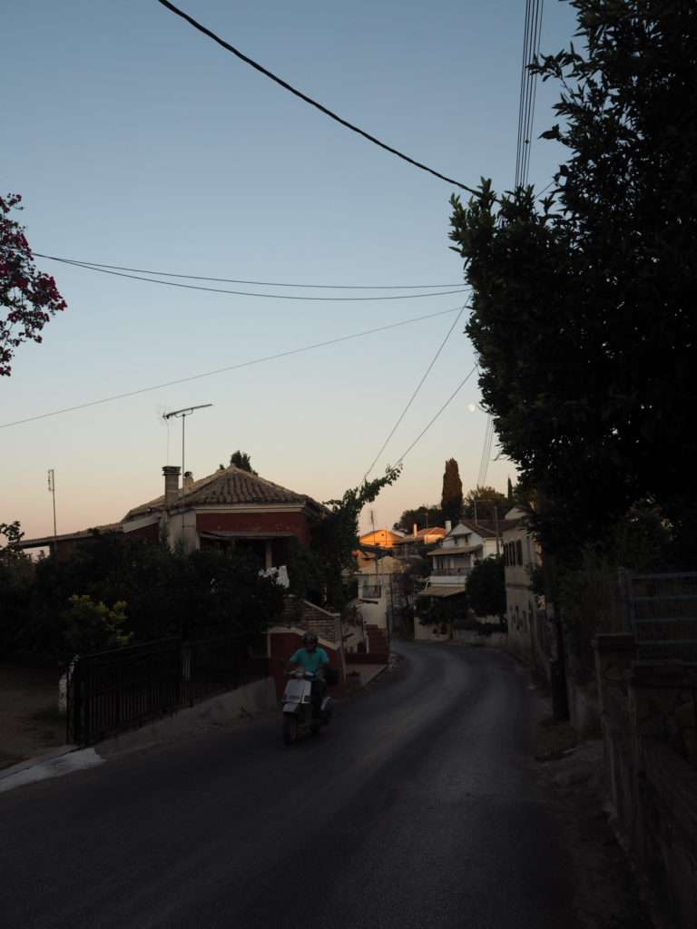 sunset on a road in corfu