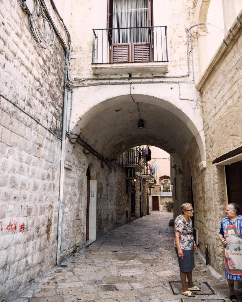 italian grandmas in an alleyway