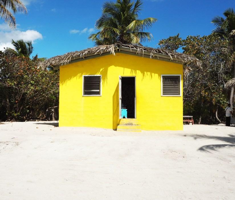 a yellow house on the beach