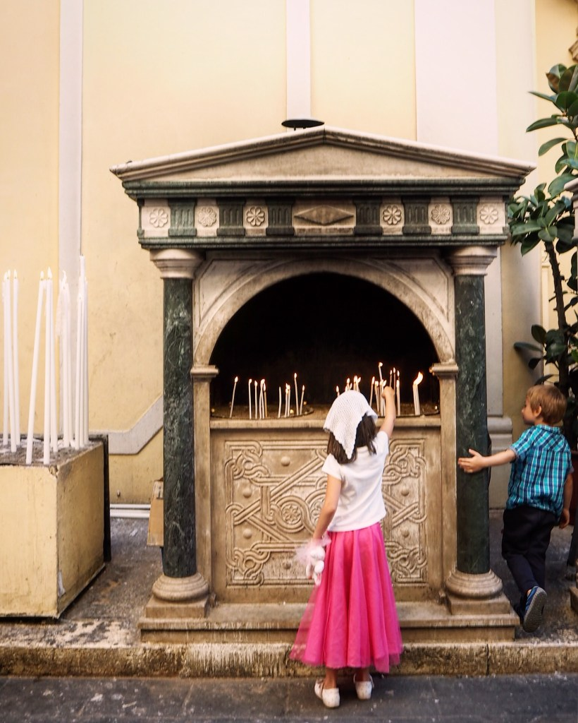 a girl leaving a candle offering