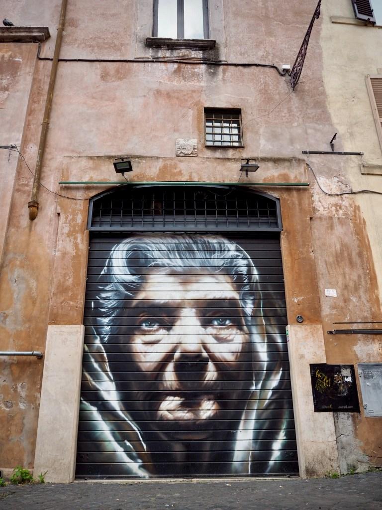 nun street art on a door