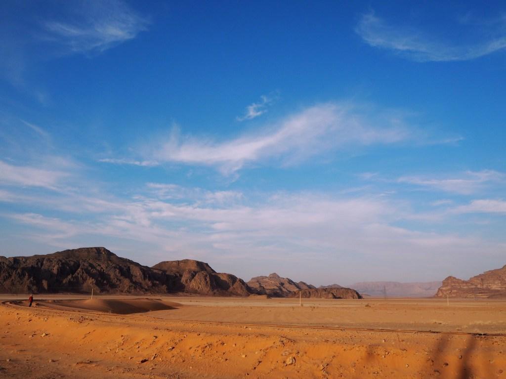 blue sky over the red sand of Wadi Rum desert