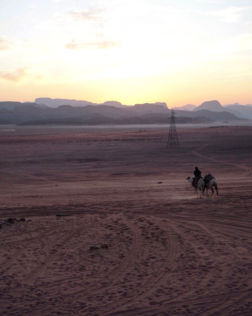 driving through Wadi Rum on a jeep tour