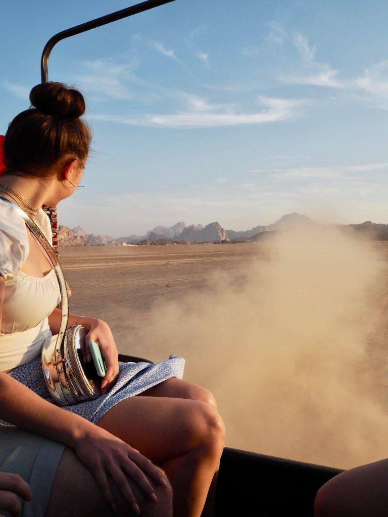 girl in the back of a jeep tour in Wadi Rum