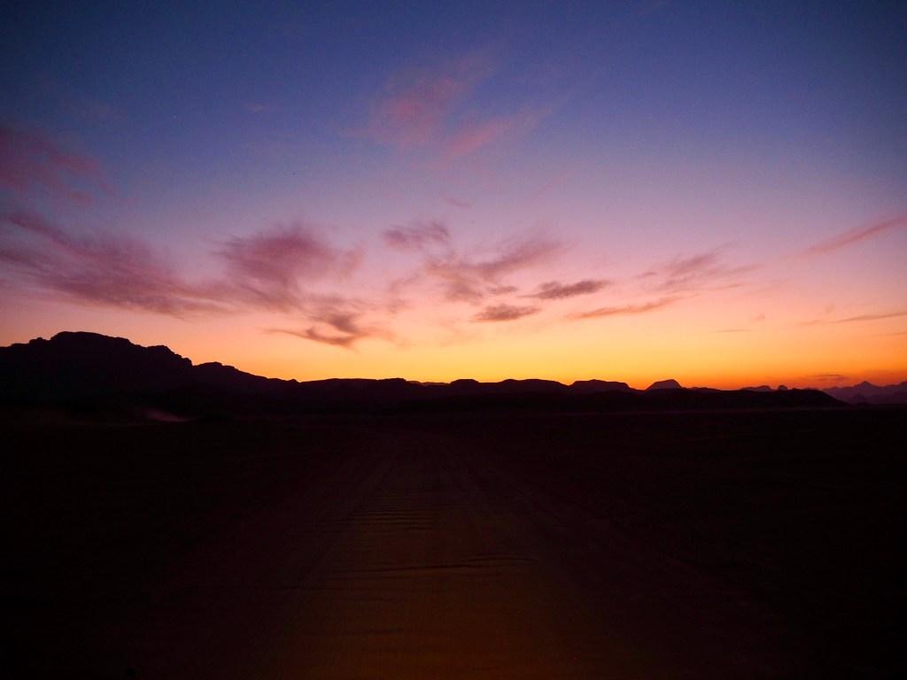 car headlights in the desert
