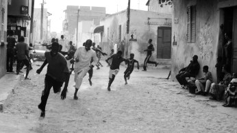 In the Senegalese city of Thies boys run away from a Zimba.
