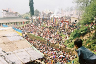 A boy in Sikkim, India overlooks a vist by His Holiness the 14th Dalai Lama. 2005