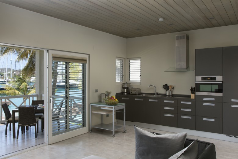 south point antigua luxury serviced apartments kitchen and lounge view