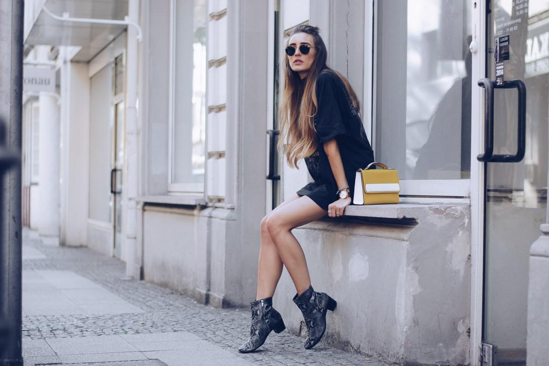Stylish woman wearing black chelsea boots