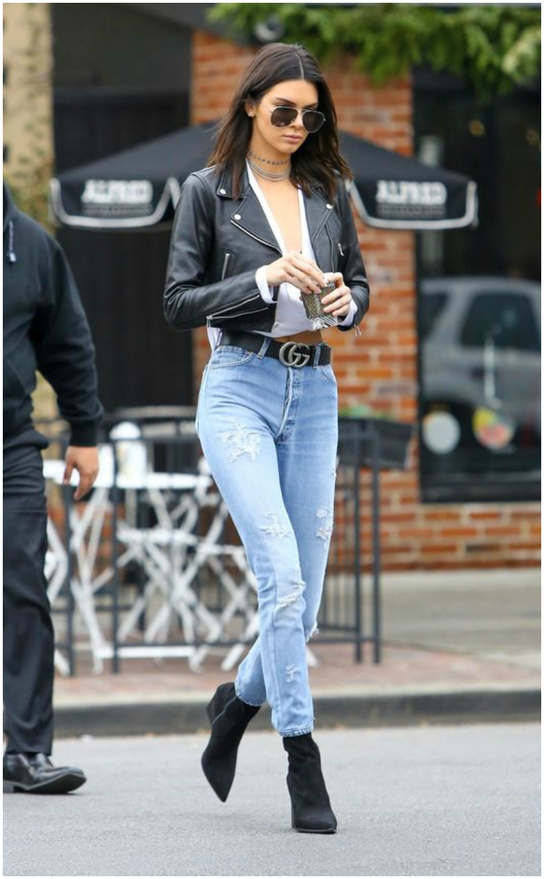 Kendall Jenner cropped black leather jacket Gucci belt high-waisted jeans