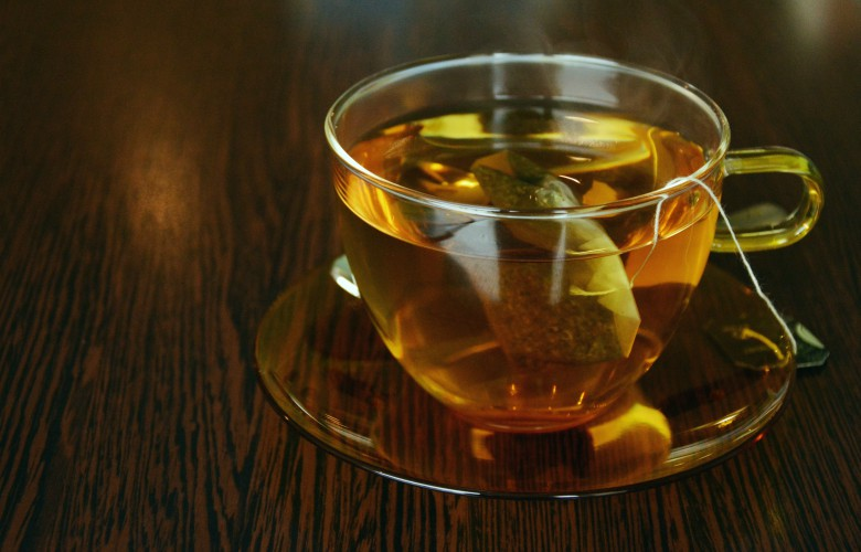 Top 5 ways to increase metabolism, green tea - a cup of tea on wooden table