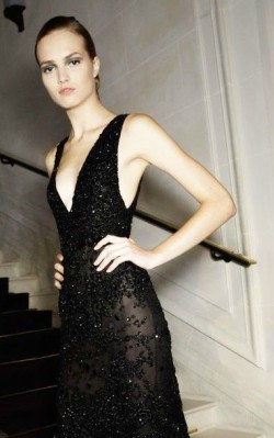 What to wear to a black tie gala - full length sequinned black gown with plunging neckline