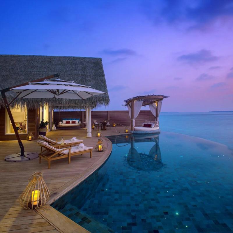 Milaidhoo water villa at dusk Maldives
