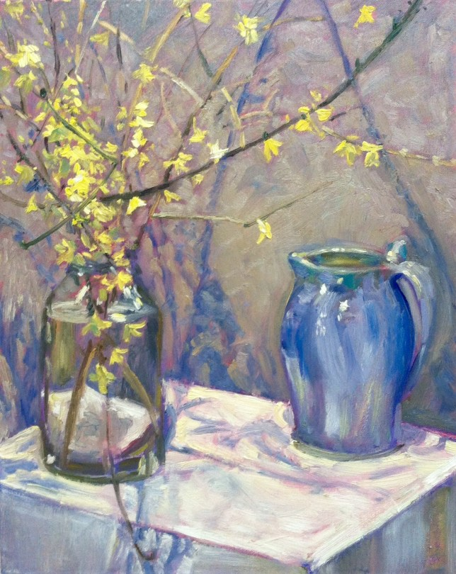 A painting of forsythia trimmings in a clear vase and a blue pitcher on a table