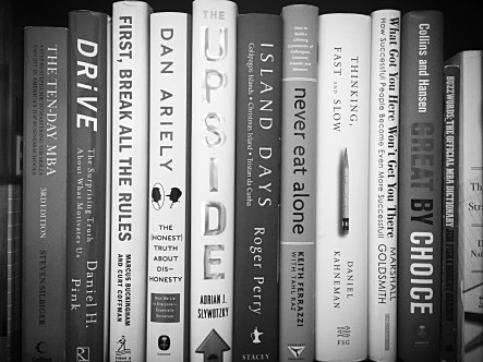 Close-up of books on a bookshelf, in black and white