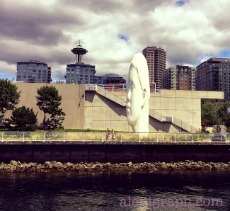 A massive white sculpture of a head in a waterfront park in Seattle